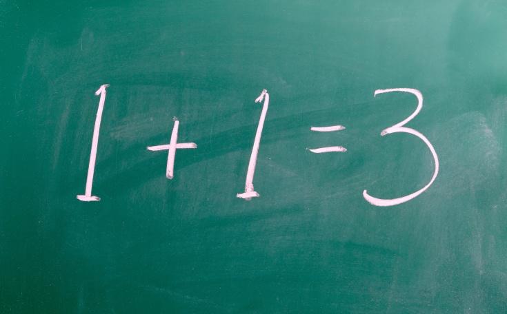 1 + 1 = 3 Chalk on blackboard